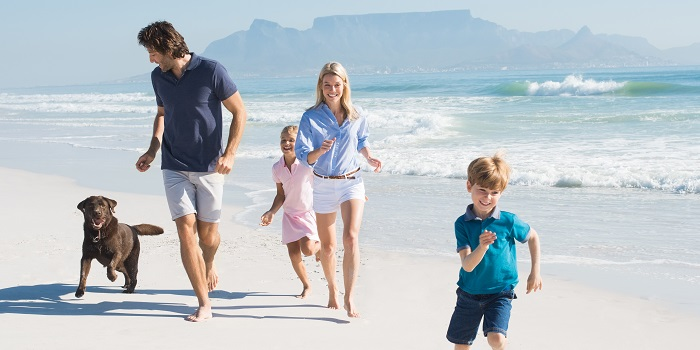 Family on holiday on beach in South Africa