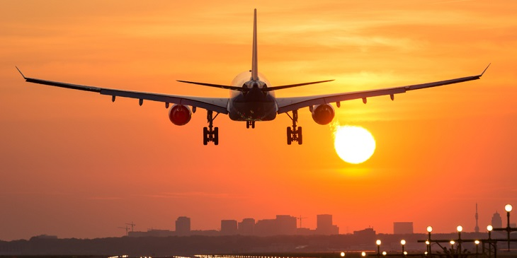Long haul aeroplane landing into sunset
